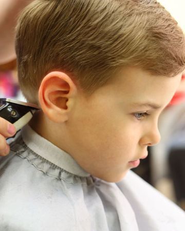 Boy getting hair cut